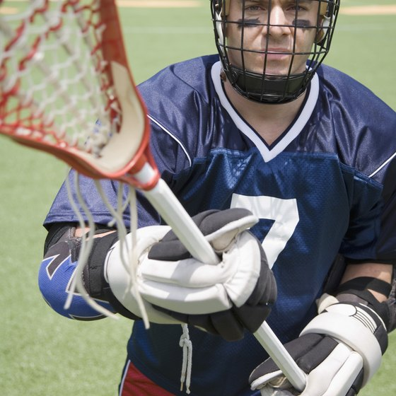 The men's lacrosse stick contains a roughly triangular mesh pocket.