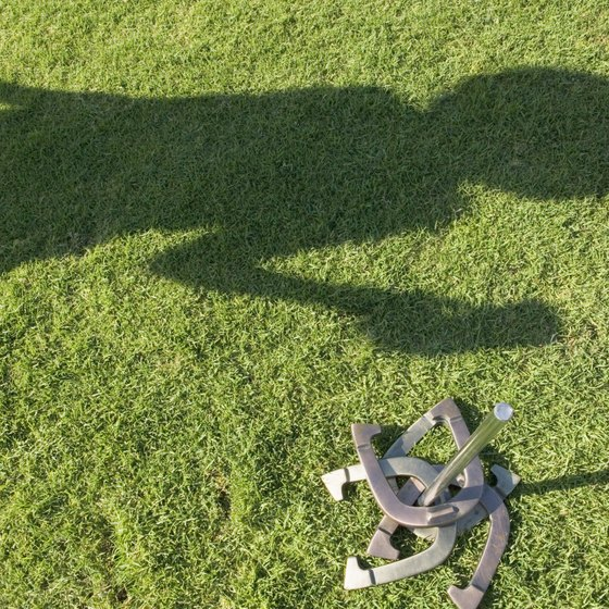 A horseshoe pit can be built on grass or dirt in your yard.