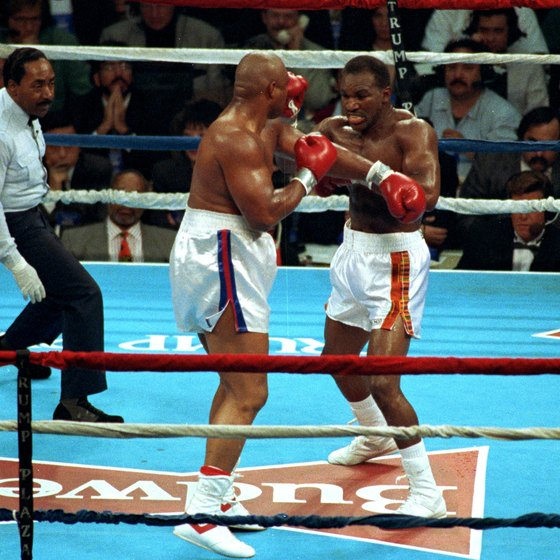 George Foreman, left, beat Evander Holyfield for the heavyweight crown at 42.