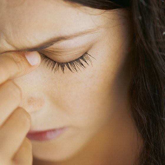 Congestion and pressure in sinuses cause headaches between the eyes.