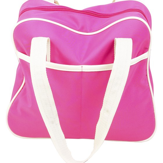 Women can pack plenty of items into a small carry-on purse or bag when traveling in a plane.