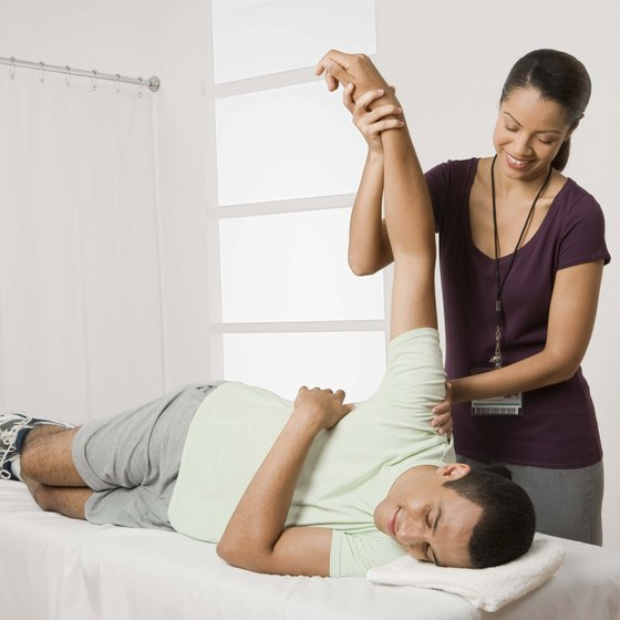 You perform most of the motion, while your therapist will assist you at the very end of the stretch.