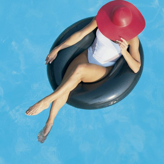 Lounging in your tube won't burn many calories, but add swimming to the mix and you have a water workout.