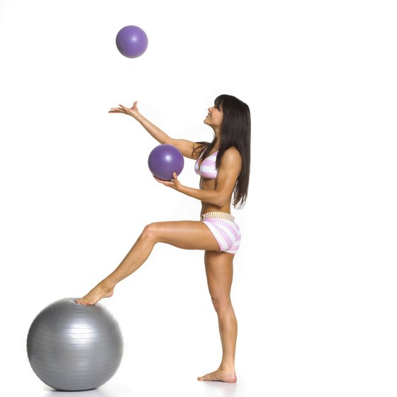 Yoga balls can enhance or help a traditional yoga routine.