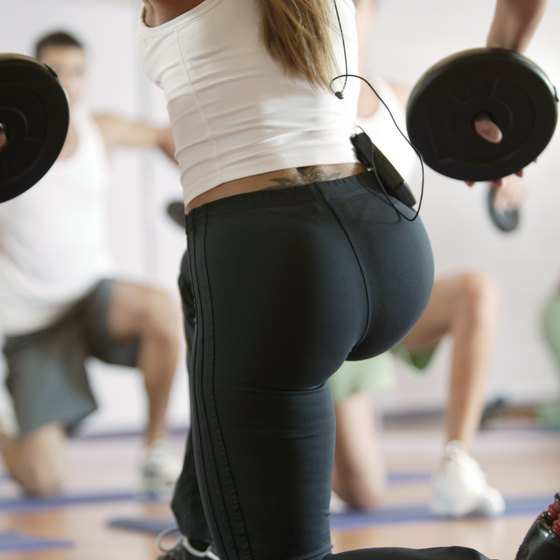 Back squats work the buttocks muscle to a great degree.