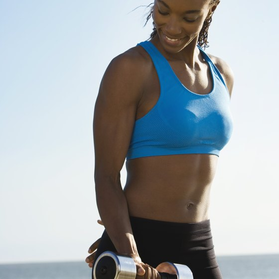 Strength training with dumbbells helps slim and tone arms.