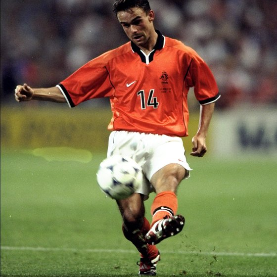 Holland's Marc Overmars, an archetypal winger, crosses the ball.