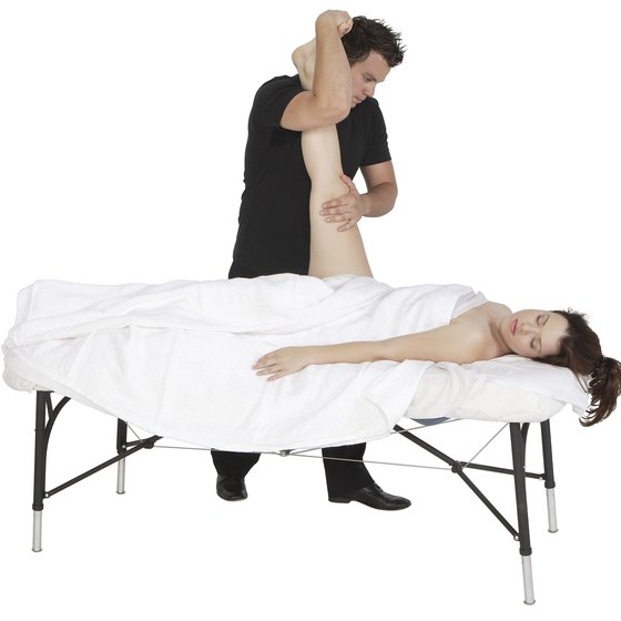 Hamstring stretch on the massage table.