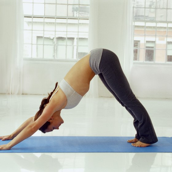 Downward-facing dog pose strengthens the arms while stretching the hamstrings, calves and feet.
