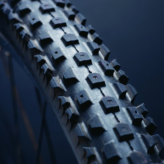 Tire treads provide grip with the riding surface.