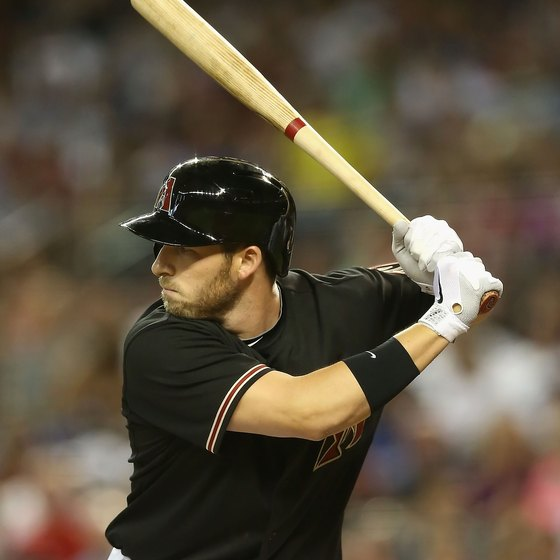 Stephen Drew of the Arizona Diamondbacks holds a wooden bat.