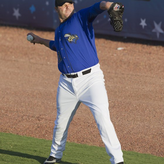 Former Major League pitcher Roger Clemens warms up before starting for the Sugar Land Skeeters in September 2012.