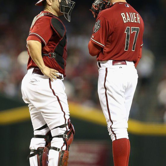 Arizona catcher Miguel Montero, left, is well protected in this 2012 game.