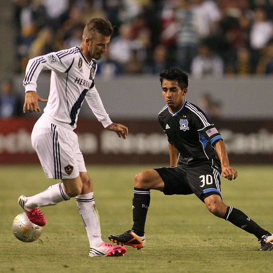Rafael Baca of the San Jose Earthquake maintains his position against the speedy David Beckham of the L.A. Galaxy.