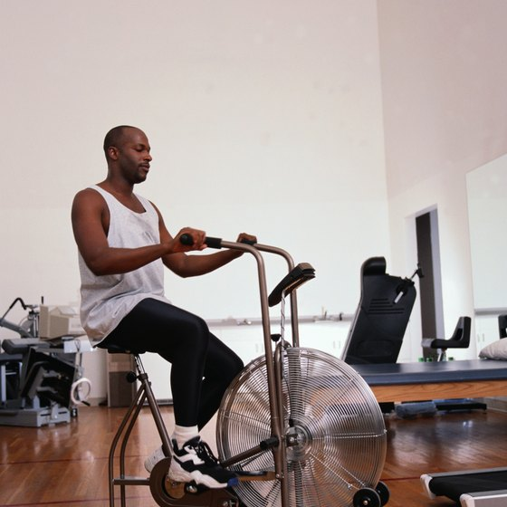 Using an exercise bike will help tone your legs and glutes.