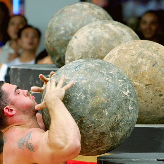 Many strongman events work your biceps and forearms.