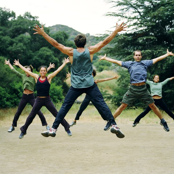 Jumping jacks are often used in aerobic classes to keep the heart rate up.