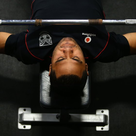 Bench press heavy weights for best results.