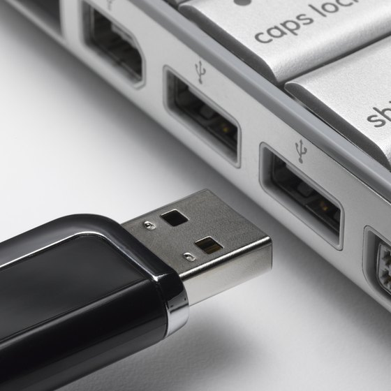 A USB drive, also known as a flash drive, allows you to conveniently move address books between a PC and a Mac.