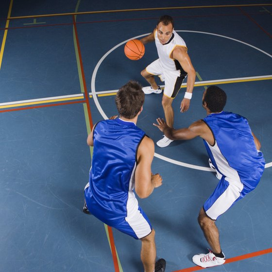Two or three players can enjoy a game on the basketball court.