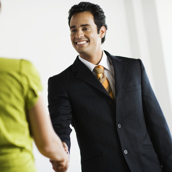 A smile and a handshake can begin the process of building relationships through appreciation marketing.