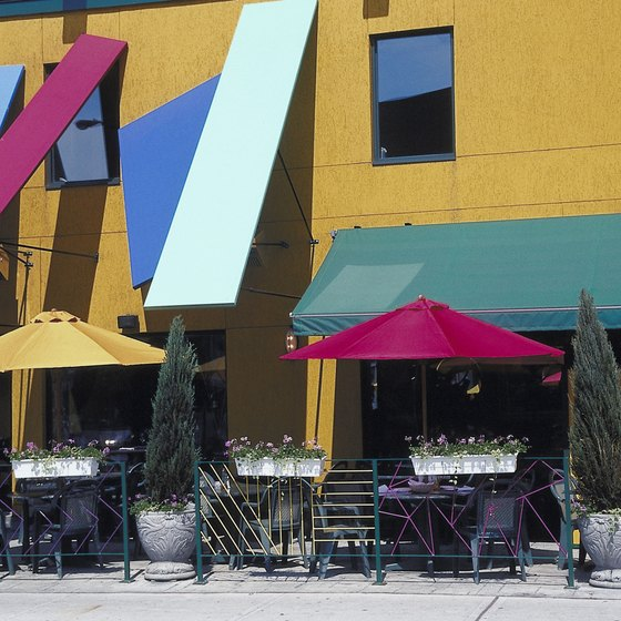 Canvas awnings in bright colors -- a great way to give a tropical feel to the exterior of your retail space.