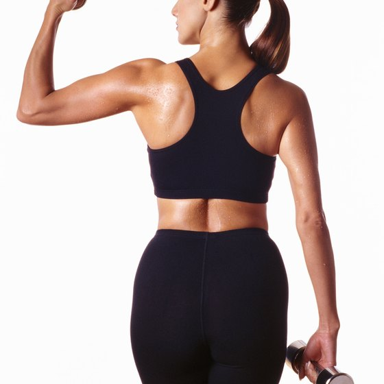 Use dumbbells at the gym to strengthen the back.