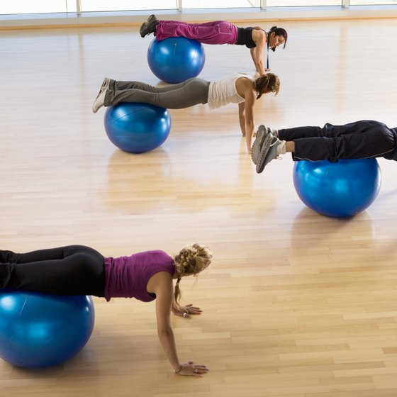 Ball knee crunches can help tone your stomach.