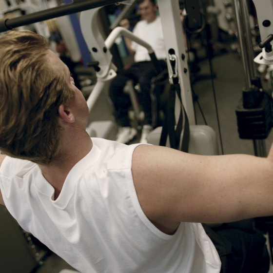 Use a lat pulldown machine to pump up your biceps.