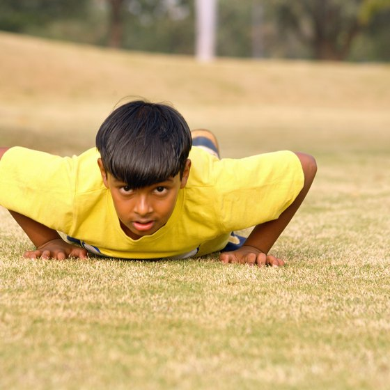 Push-ups are a good way for children to build muscle.