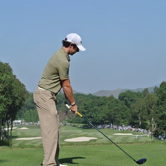 Bend from the waist at address to avoid an over-the-top swing.