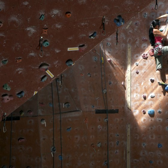 Indoor rock climbing tones your legs, buttocks and upper body.