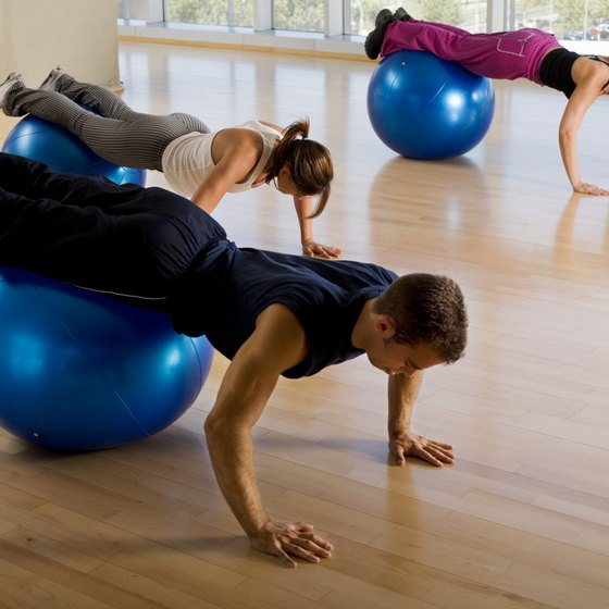 Simulate the moves on a Roman chair using a stability ball.