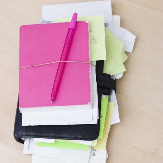 Gather notes, research and organizational documents to help write a proposal.