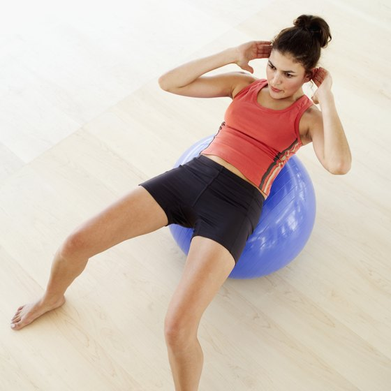 Tone the abdominals with stability ball crunches.