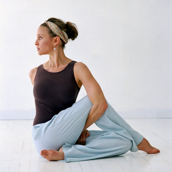 Yoga activities stretch tight muscles and improve flexibility.