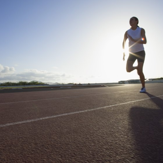 Running your daily mile on a track can help you time your laps and work toward increasing speed.