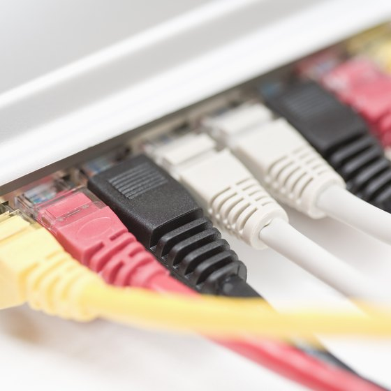 Multiple Ethernet patch cables connect to a workgroup switch.