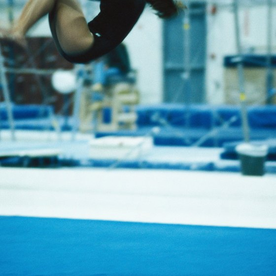 A gymnast relies on anaerobic energy stores for tumbling passes on the floor routine.