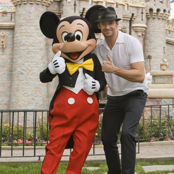Actor Hugh Jackman hangs with Mickey Mouse at Disneyland.
