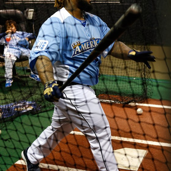 Prince Fielder takes some swings from an indoor batting cage.