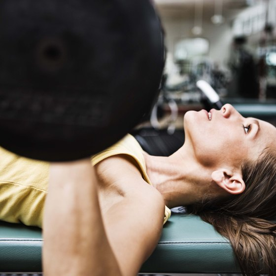 Compound exercises such as this bench press can help you gain healthy muscle weight.