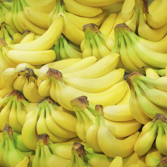 A pile of bananas at a market.