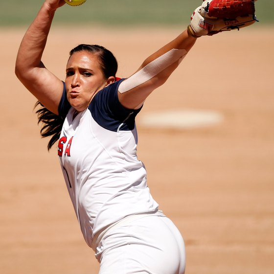 Fastpitch hurlers rotate their arms in a circle before delivering the ball.