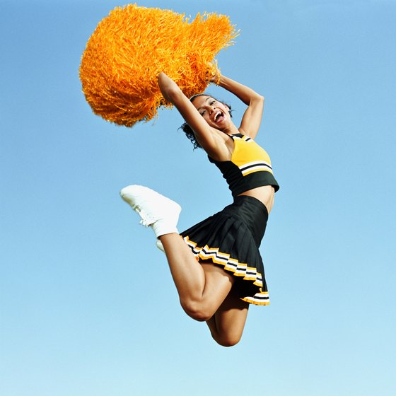 College cheerleading requires full-body strength.