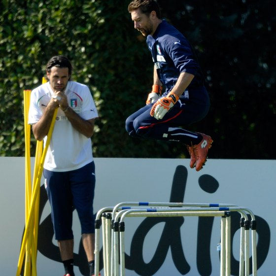 Members of Italy's national soccer team hone their agility on hurdles.