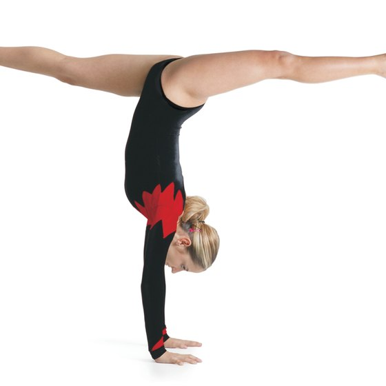 Gymnasts develop agility, flexibility, balance and strength while doing gymnastics.