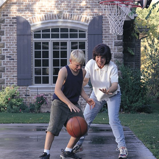 Driveway basketball courts make for family fun.