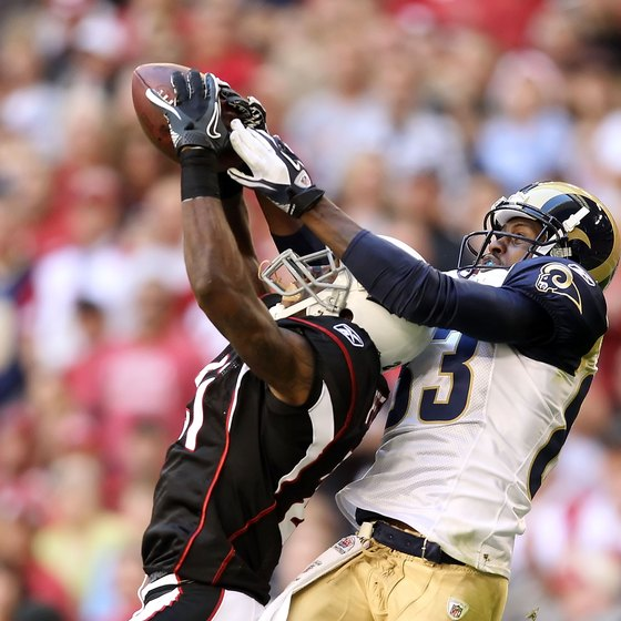 Arizona's Patrick Peterson cuts in front of St. Louis receiver Austin Pettis to intercept a pass.