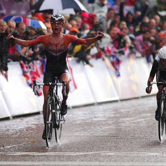 A ferocious sprint brings Marianne Vos of the Netherlands, left, a gold-medal finish.